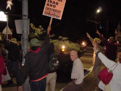 photo: Anti-war demonstrators stopping a tank in the streets