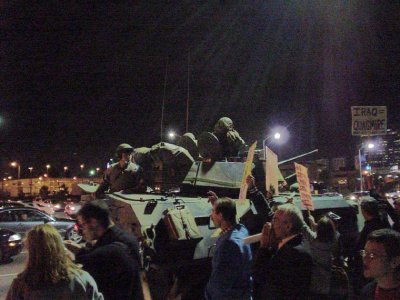 photo: Anti-war demonstrators facing a tank in the streets
