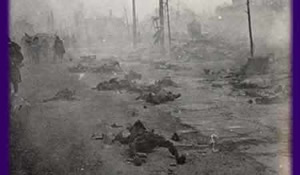 photo: burnt corpses lie in a ruined street