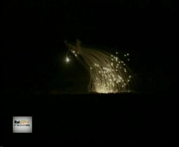shower of white fire exploding over Fallujah