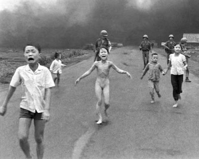Phan Thi Kim Phuc screams in pain after being burned by napalm in her village