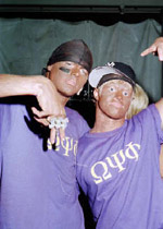 photo: white Beta Theta Pi frat brothers flash gangsta poses in blackface. Auburn, Halloween 2001