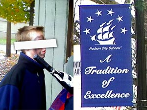 "photo: An adolescent white boy walks from a football game wearing blackface makeup / a sign in downtown Hudson reads ""A Tradition of Excellence"""