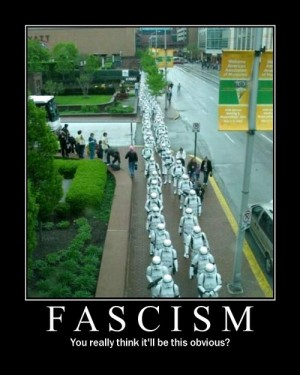It has a photo of a column of people dressed as Imperial Storm Troopers from Star Wars is marching down a city street. Caption: Fascism: You really think it'll be this obvious?