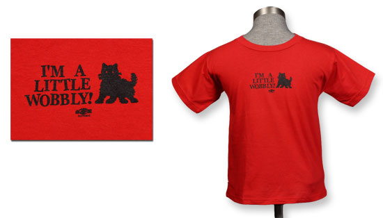 It's a little red and black t-shirt for a toddler, with a cartoon of a black kitten and the words I'm A Little Wobbly