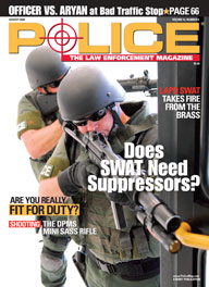 Here's a cover with a photo of two armored SWAT police coming around the corner, with the one in front pointing a huge shotgun obliquely towards the camera.