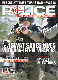 "Here's a cover with a photo of a heavily armed SWAT police, with a helmet and body armor, charging directly at the camera with a shotgun pointed directly at the camera, with the headline ""SWAT Saves Lives""."