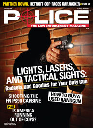 Here's a cover with a photo of a cop standing in darkness, pointing a lit-up handgun obliquely at the camera.