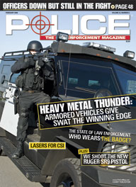 "Here's a cover with a photo of heavily armed SWAT police standing in the door of a huge armored vehicle, aiming a shotgun obliquely at the camera, with the headline ""Heavy Metal Thunder: Armored Vehicles Give SWAT the Winning Edge"""