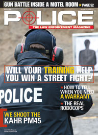 Here's a cover with a photo of a cop aiming a gun at the target on a training range.