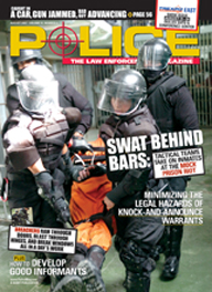 "Here's a cover with a photo of a gang of heavily armored SWAT police, with face-plated riot helmets and heavy body armor, forcing a prisoner in an orange jump suit to the ground, captioned ""SWAT behind bars""."