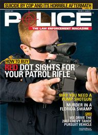 Here's a cover with a photo of a cop in an ordinary blue duty uniform looking through the site of a huge assault rifle, pointed at a target off-camera.