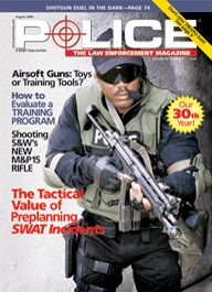 Here's a cover with a photo of a SWAT police in body armor, wearing sunglasses and squared off facing the camera, with a large assault rifle in his hands.