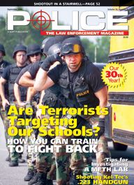 "Here's a cover with a photo of a line of about 5 or 6 armored SWAT police in body armor and helmets, coming around the corner of a yellow school bus, with the caption ""Are Terrorists Targeting Our Schools?"""