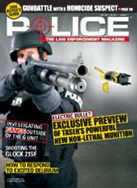 Here's a cover with a photo of an armored SWAT police firing a huge TASER shotgun obliquely at the camera, with the shock-delivery projectile actually flying out towards the viewer.