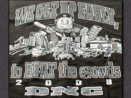 "It's a black t-shirt with a cartoon of a giant policeman looming over the skyline of Denver, holding an oversized bat, with the caption ""We get up early, to BEAT the crowds / 2008 DNC"