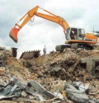 Here's a photo of a back-hoe and the rubble of a demolished building. That's what the government calls...