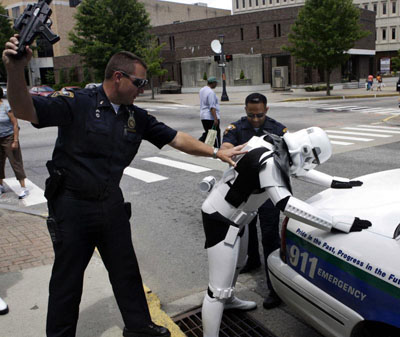 Here's a photo of a pair of cops hassling a guy in an Imperial Stormtrooper costume.