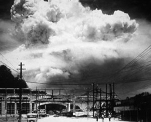 Here is a mushroom cloud, seen from the ground, towering into the sky over a bridge in Nagasaki.