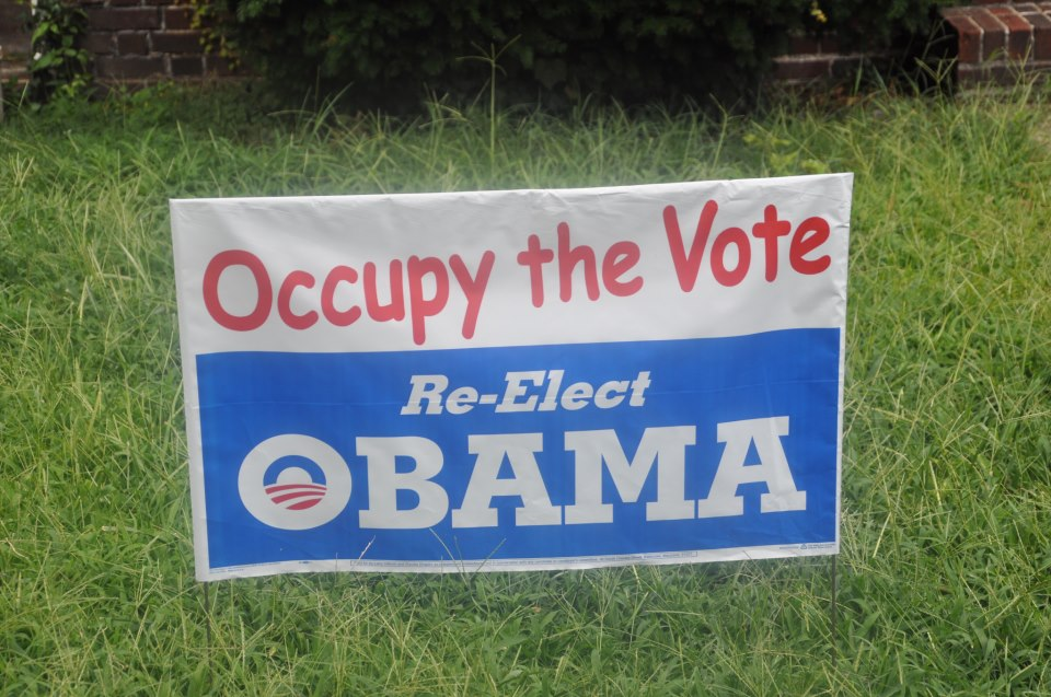 "Here's a photograph of a campaign yard sign. The top half reads: ""Occupy the Vote."" The bottom half, in red, white and blue, reads: ""Re-Elect OBAMA."""