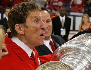 Mike Ilitch holds the cup