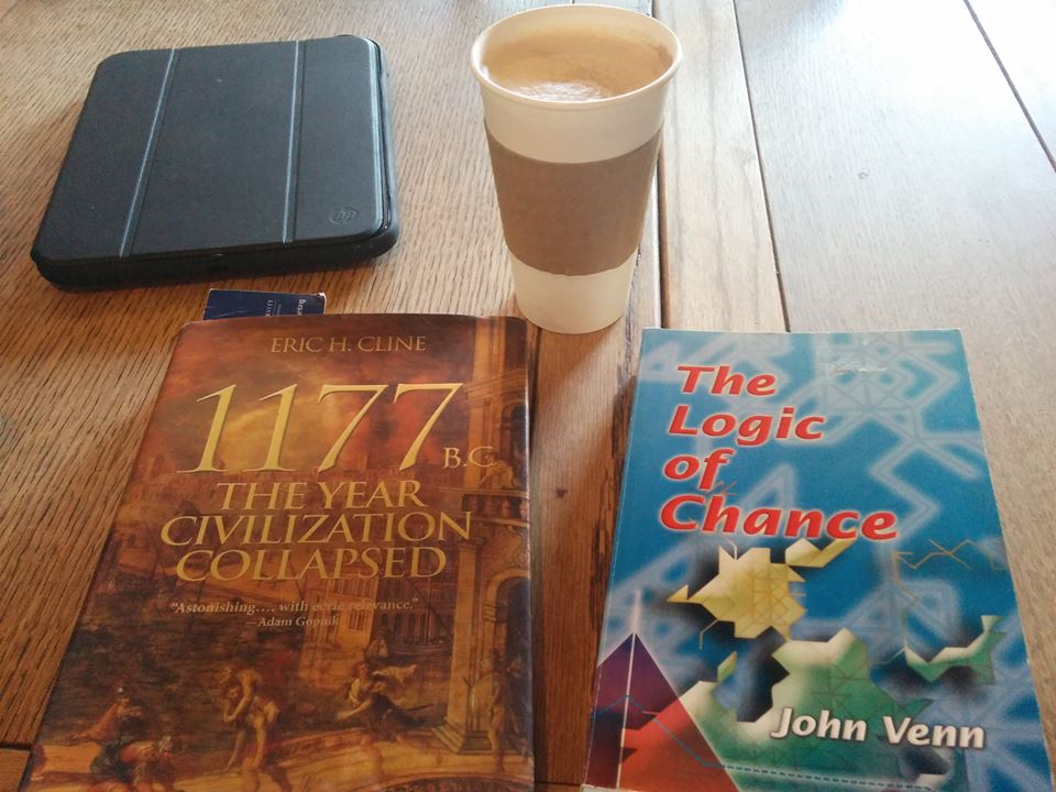 Here is a picture of Eric H. Cline's 1177 B.C.: The Year Civilization Collapsed and John Venn's The Logic of Chance, along with a tablet computer and a cafe au lait.