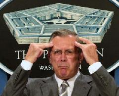 photo: Donald Rumsfeld clutches his head