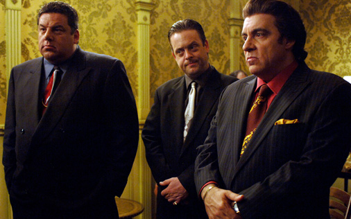 Here are three mobsters standing together, in a scene from the Sopranos.