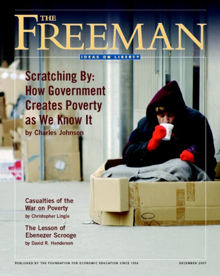 "Here's the cover of the December 2007 Freeman, with a photo of a homeless man sitting in a box drinking coffee. The top cover story is ""Scratching By: How Government Creates Poverty As We Know It"" by Charles Johnson."