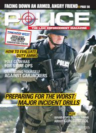 Here's a cover with a photo of an armored SWAT police charging towards the camera, holding an assault rifle that's currently pointed at the ground.