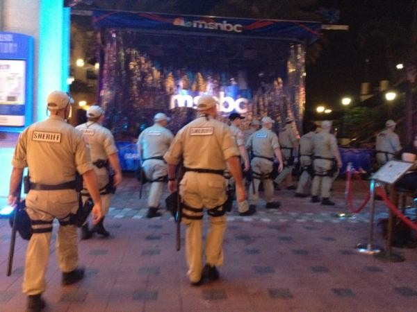 (A photograph of a crowd of sheriffs walking past an MSNBC pavilion.)