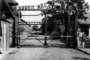 "photo: Gate of Auschwitz. Over the top are the words ""ARBEIT MACHT FREI"""