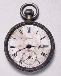 Here is a pocket watch, stopped at 8:15am.